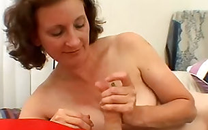 Amateur whore Pandora is giving her lover a sensual handjob on camera