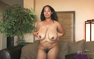 Huge mature boobs come out during her interview