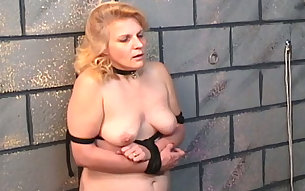 Lustful whore is spanked hard on her bottom by her bondage master