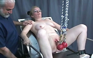 Mature BBW slut getting her pussy lips stretched in BDSM clip