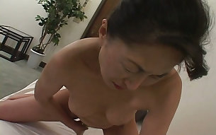 Horny Japanese mom pleasing her coochie with big vibrator