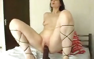 Slutty wench rides her huge black dildo masterfully like it is a real thing