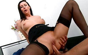 Stacked brunette strumpet in stockings rides big penis in face to face style