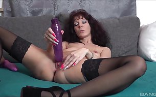 Solo mature model Samy Saint spreads her legs for pussy drilling