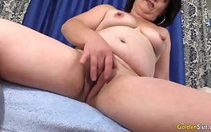 Dark haired granny shows her tits and play with her pussy