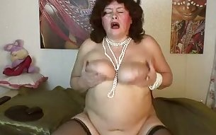 This moaning mature slut has some big saggy tits and she loves to touch them