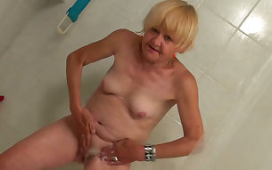 Chubby blonde granny in the bathroom flashing nude on cam