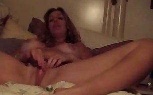 Nasty mature mommy rubs her shaved cunt waiting for me to join her