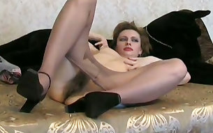 Amateur Isolda in nylon pantyhose tickles her extremely bushy cunt