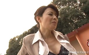 Glamorous mature Japanese babe with big tits getting her hairy pussy pounded in car before giving erotic blowjob