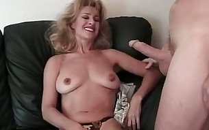 Blond haired mature bitch Mia and her wild man present hot sex on leather sofa