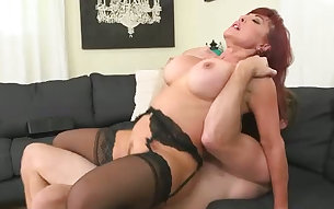 Busty mature redhead in black stockings gets doggy fucked rough