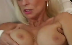 Spoiled mature blondie gets her pierced muff toyed tough before pleasing kinky guys with rimjob