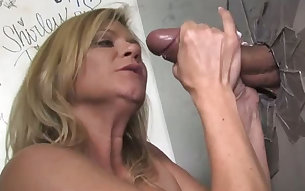 Wanton fair haired mommy Ginger Lynn is to blow dick through glory hole