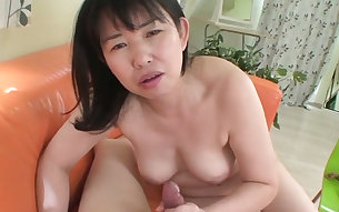 Mature Japanese fuck doll pleases her guy with stout blowjob
