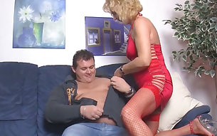 Fat hubby and his wanton mature blonde in sexy red lingerie have nasty oral sex on sofa
