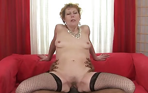 Short-haired granny in sexy stockings is riding her lover's ebony schlong