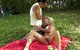 Oiled up granny is ass fucked bad on a load outdoor