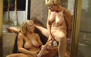 Busty mature women having kinky lesbian sex in the bathroom