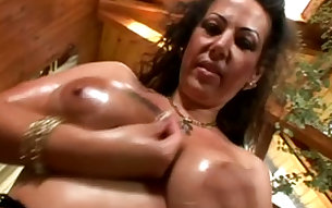 Oiled up mature mom giving deepthroat blowjob