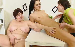 Obese and ugly lesbian teacher plays with two petite college babes