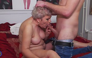 Granny gives head and gets fucked by a young guy