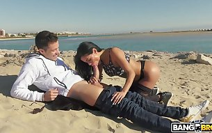 Perverted buxom bitch Canela Skin blows and rides strong cock on the beach